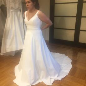 Trying on original dress